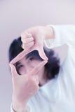 Asia beutiful girl make hand symbol frame Royalty Free Stock Photo