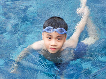 Asia boy kid child nine years old in swimming pool Stock Photos