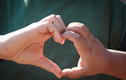 Asia boy make hand in heart form. Stock Photos