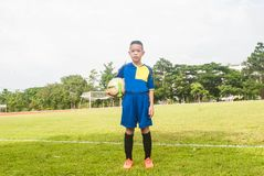 Asia boy playing Soccer football field stadium grass line ball b Stock Image