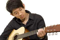 Asia boy plays his guitar Royalty Free Stock Image