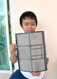 Asia boy show air conditioner filter have dust Royalty Free Stock Photos