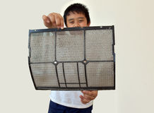 Asia boy show air conditioner filter have dust Stock Photo