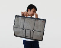 Asia boy show air filter dust Stock Image