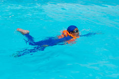 Asia boy swimming in the pool. Asia boy swimming in the blue pool Royalty Free Stock Images