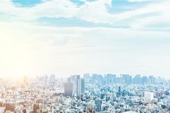 Panoramic modern city urban skyline bird eye aerial view under sun & blue sky in Tokyo, Japan. Asia Business concept for real estate and corporate construction royalty free stock images