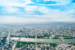 Panoramic modern city urban skyline bird eye aerial view under sun & blue sky in Tokyo, Japan. Asia Business concept for real estate and corporate construction royalty free stock image