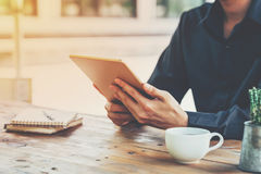 Asia business man holding tablet on table in coffee shop with vi Stock Photography