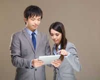 Asia business man and woman using tablet Royalty Free Stock Photo