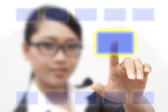 Asia business woman. A portrait of Asia business woman. pressing her finger on touch screen Stock Photography
