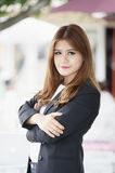 Asia business woman with arms crossed standing in her office Royalty Free Stock Photos
