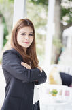 Asia business woman with arms crossed standing in her office Royalty Free Stock Images