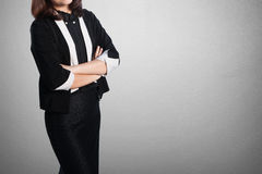 Asia Business woman cross arms on blank wall for text and background Royalty Free Stock Photos