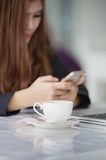 Asia business woman texting messages on smartphone in cafe royalty free stock photos