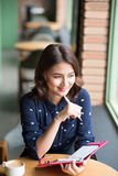 Asia business woman working  planning concept in a cafe. Stock Image