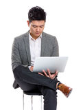 Asia businessman concentrate reading on laptop Stock Images