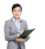 Asia businesswoman with filepad Royalty Free Stock Image