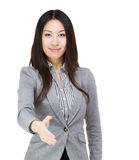 Asia businesswoman give handshake Stock Images