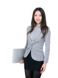 Asia businesswoman holding laptop Stock Images