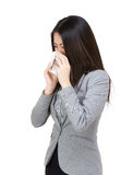 Asia businesswoman sneeze. Isolated on white Stock Image