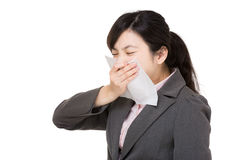 Asia businesswoman sneeze. Isolated on white Royalty Free Stock Images