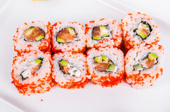 Asia. California rolls with salmon red fish on a white plate o Stock Image