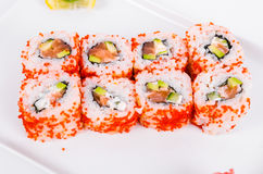 Asia. California rolls with salmon red fish on a white plate o Stock Photos