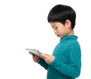 Asia child reading on tablet Stock Images