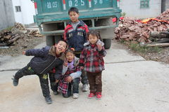 Asia children. Asia, China,The children put on all kinds of gestures and facial expression to be photographed royalty free stock photo