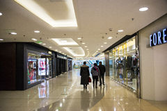 Asia China, Beijing, APM shopping center, indoor. China, Beijing,, APM shopping center, the Wangfujing shopping district, one-stop modern model, the daily trend Stock Photography