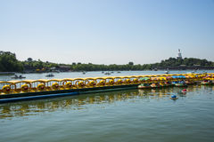 Asia China, Beijing, Beihai Park,Lake view, yellow duck boat Stock Photos