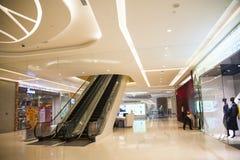 Asia China, Beijing, Chang Ying Tian Jie shopping center, escalator Royalty Free Stock Images