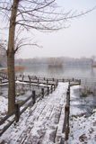 Asia China, Beijing, Chaoyang Park, winter scenery, wood bridge, snow Royalty Free Stock Image