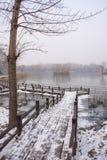 Asia China, Beijing, Chaoyang Park, winter scenery, wood bridge, snow Royalty Free Stock Image