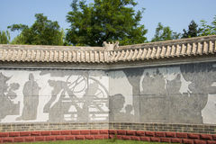 Asia China, Beijing, Chinese Cultural Park, antique buildings, Art wall, sculpture Stock Images