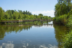 Asia China, Beijing, Guishui River Forest Park,Garden scenery,  The lake, wooden bridge Royalty Free Stock Photo