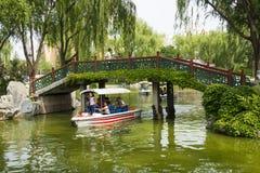 Asia China, Beijing, Longtan Lake Park, Summer landscape, wooden bridge, a cruise ship Royalty Free Stock Image