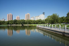 In Asia, China, Beijing, lotus pond park,Lakeview, modern architecture Royalty Free Stock Photo