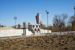 Asia China, Beijing, Olympic Park, Olympic rings, torch. Asia China, Beijing, Olympic Park, urban landscape architecture, Olympic rings, torch Stock Image