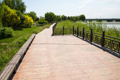 Asia China, Beijing WanPinghu Park, Scenery of gardens, trails, wood railings Stock Photos