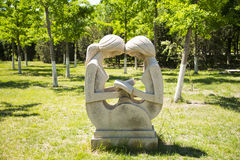 Asia China, Beijing, Yang Shan Park, landscape sculpture,Two girls reading Stock Photo