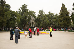 Asia China, Beijing, Zhongshan Park,Statues and garden flowers Royalty Free Stock Photos