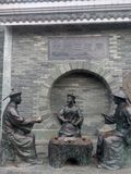 Asia,China,guilin , the three Statue of  teaing Qing officials in the park Royalty Free Stock Photo
