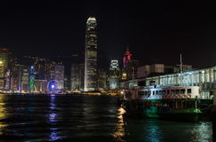 ASIA CHINA HONGKONG. Landscape starferry in Hongkong traditional a boat night scenes. Central urban famous tourism touristic lamp night river harbor light travel Royalty Free Stock Photo