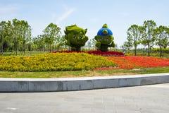 Asia China, Wuqing, Tianjin, Green Expo,Landscape grass carving, cartoon mascot. Asia China, Wuqing, Tianjin, Green Expo, garden landscape flower beds, grass Royalty Free Stock Photos