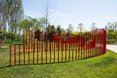 Asia China, Wuqing, Tianjin, Green Expo, the park landscape, A wall of red PVC tubes. Asian China, Wuqing, Tianjin, Green Expo, green grass, with a red PVC tube stock photos