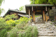 Asia Chinese, Beijing, China Minzu Yuan,Copycat, village gate, step. Beijing Chinese Min zu Yuan, traditional architecture, China minority ethnic customs, large Stock Photo