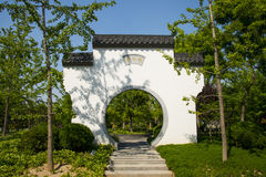 Asia Chinese, Beijing, Garden Expo,Garden building, white wall gray tile circular door Stock Images