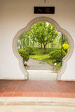 Asia, Chinese, Beijing, garden, flower shaped door Stock Images