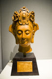 Asia Chinese, Beijing, National Museum, Contemporary Art Biennale,Gold-rimmed nanmu, Buddha head,A Buddism godness Guanyin. China and Asia, Beijing, National Stock Images